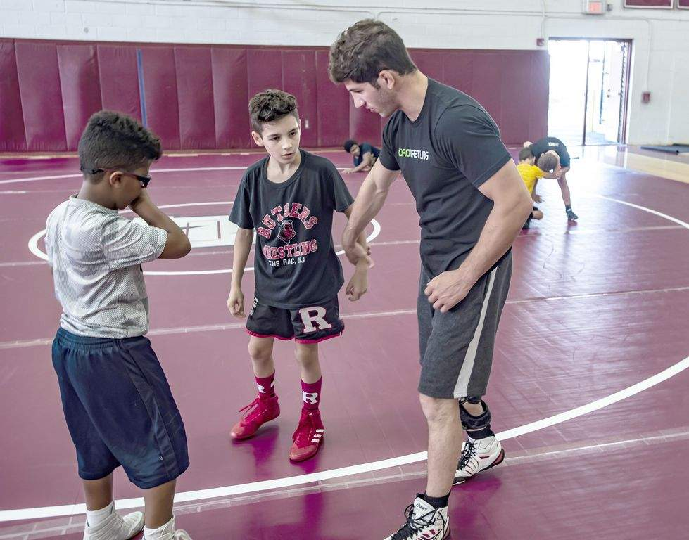 Rutgers national champ Ashnault instructs at Newton camp